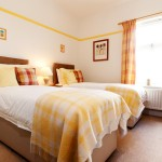 the yellow room - showing twin beds